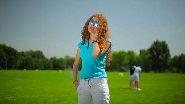 Cover Image for Woman Talk on the Phone at the Course