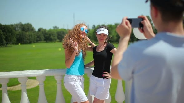 Thumbnail for The Man Photographing Two Girls Near The Course