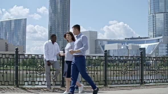 Thumbnail for Business People Walking along Riverside