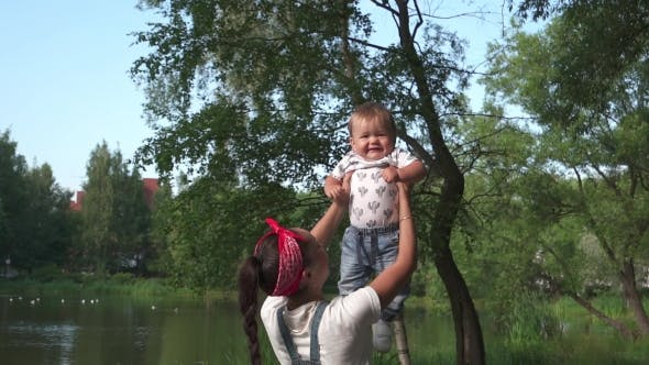 Thumbnail for Mothe Playing With Baby At Outdoor