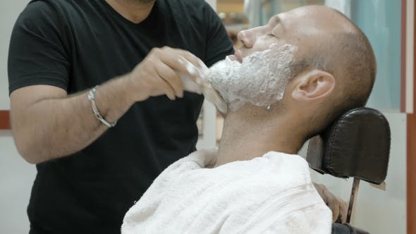 Thumbnail for A Man Is Sitting At a Barber's Shop To Get Groomed