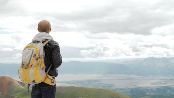 Thumbnail for Hiker Looking At View In High Altitude Mountain Above The Clouds.