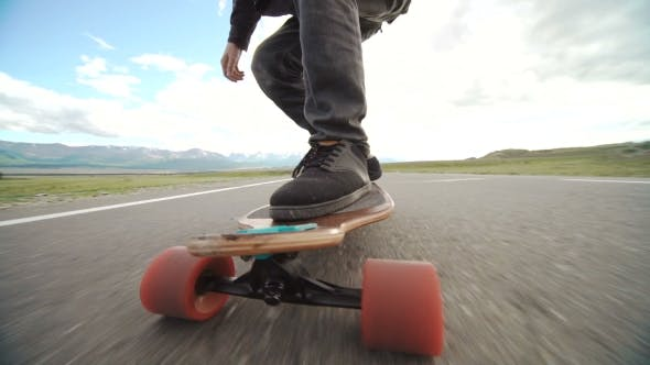 Thumbnail for Guy On His Longboard Skate.  Of Longboard And Foot. Side View. Tracking Shot