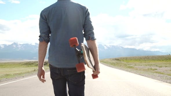 Thumbnail for Sport, Leisure, People And Teenage Concept - Smiling Young Man Or Teenager With Longboard On