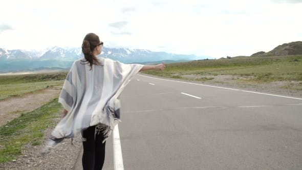Thumbnail for Young Woman Hitch-hiking On a Road At The Fields