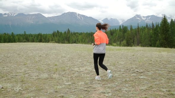 Thumbnail for Senior Woman is Getting Ready Jogging Round the Tarn in Beautiful Mountains