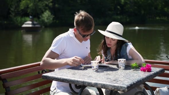 Thumbnail for The Couple Drinking Coffee Near The River