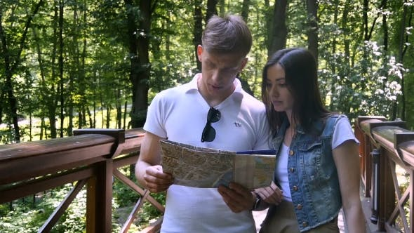 Thumbnail for Young Couple Looking At The Map And Decide To Go