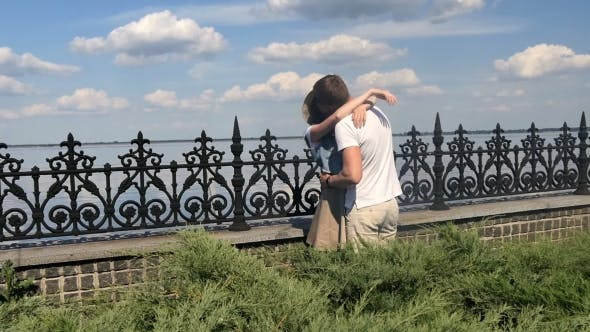 Thumbnail for The Guy And Girl Kiss On a Background Of The River