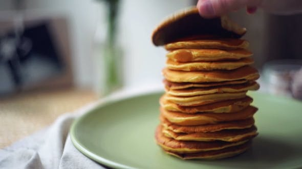 Thumbnail for Man Take One Pancake From Stack Of Pancakes