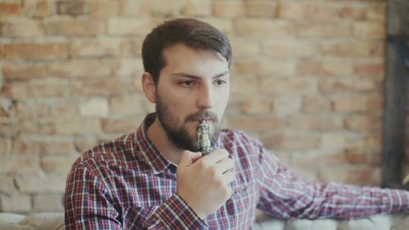 Thumbnail for Man Smoking Electronic Cigarette Vapor