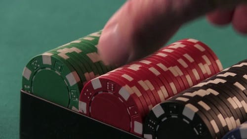 Red Poker Chips Taken Out Of The Box