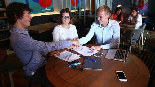 Young Smart Business Team Shaking Hands Agree Make Pact