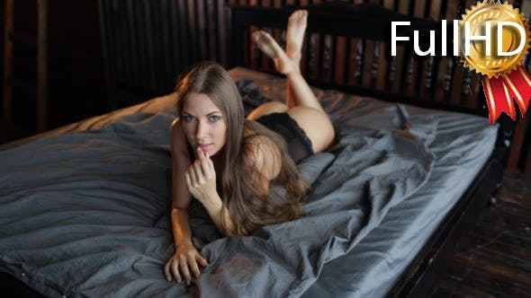 Thumbnail for Woman Model in Black Lingerie Posing on the Bed