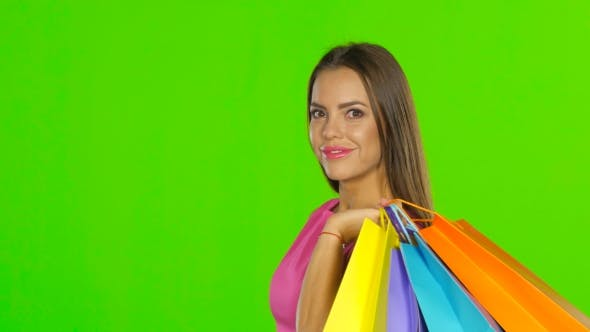 Thumbnail for Woman Holding Shopping And Money. Green Screen.