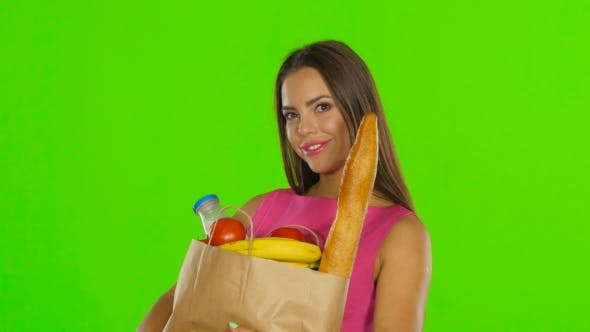 Thumbnail for Woman Holding Bag With Groceries Food. Green Screen.
