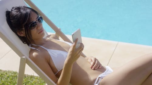 Young Woman Relaxing In a Deck Chair