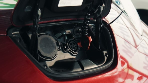 Thumbnail for Red Electric Car  On The Charging Point