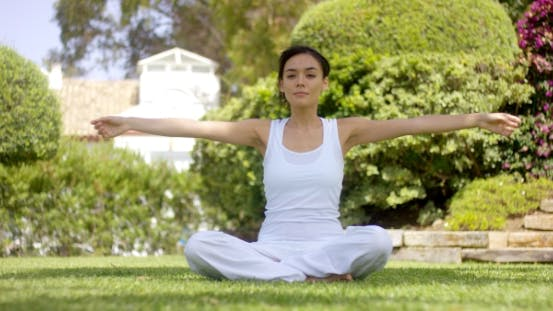 Thumbnail for Gorgeous Young Woman In White Sitting On Lawn