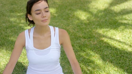 Young Woman Meditating In Nature