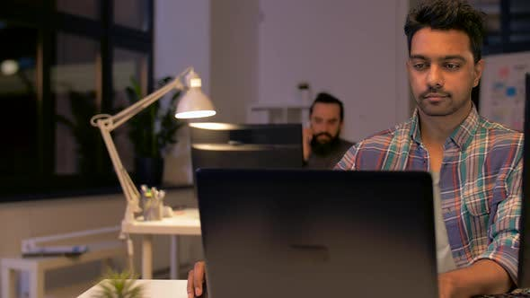 Thumbnail for Indian Man with Laptop Working at Night Office 44