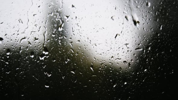 Thumbnail for Water droplets on glass. Rain drops on window glass