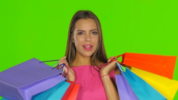 Thumbnail for Woman Holding Shopping Bags And Smiling