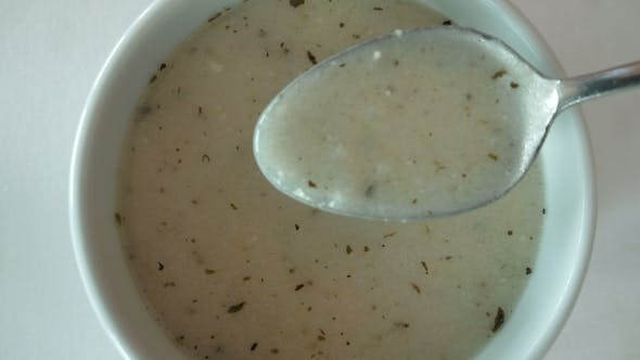 Thumbnail for A Bowl Filled With White Creamy Soup With Spices