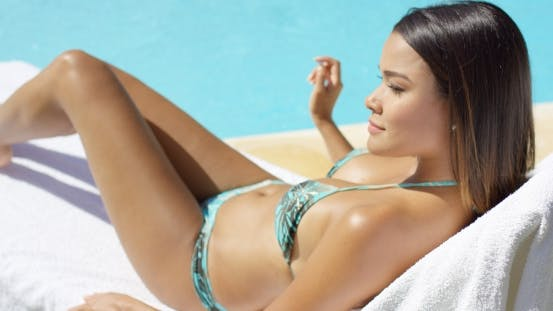 Thumbnail for Pretty Young Woman Tanning In The Summer Sun