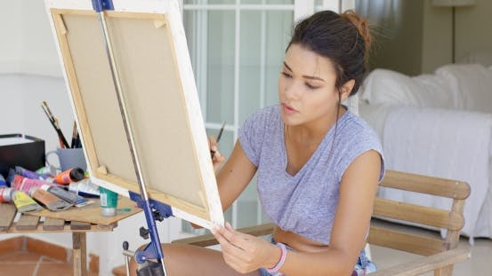 Thumbnail for Attractive Female Artist Working On a Canvas