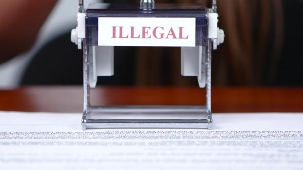 Thumbnail for Financial Worker Puts a Stamp On The Illegality Of The Document.