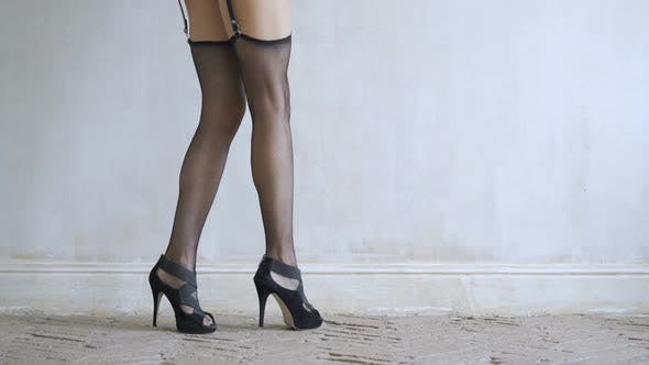 Cover Image for Sexy Girl Walking on the Floor in Black Lingerie