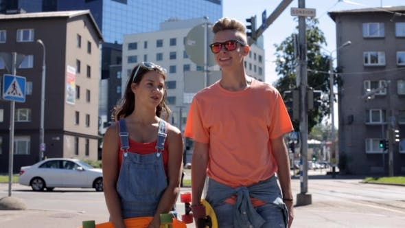 Thumbnail for Teenage Couple With Penny Boards Walking In City 10