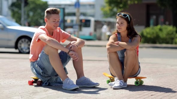 Thumbnail for Teenage Couple With Penny Boards Talking In City 29