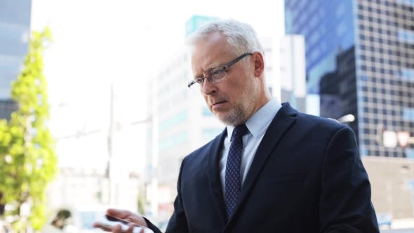 Thumbnail for Senior Businessman Calling On Smartphone In City