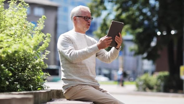 Thumbnail for Senior Man Having Video Call On Tablet Pc In City