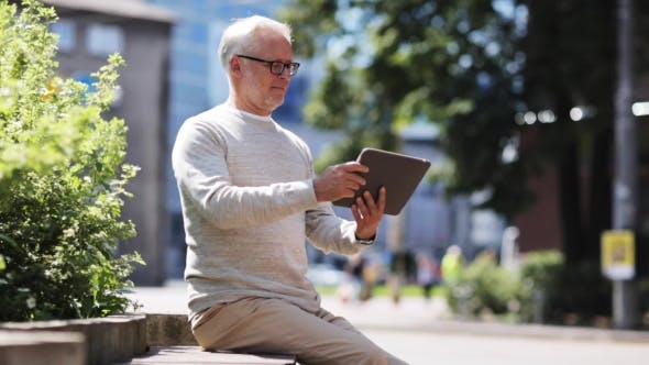 Thumbnail for Senior Man With Tablet Pc On City Street