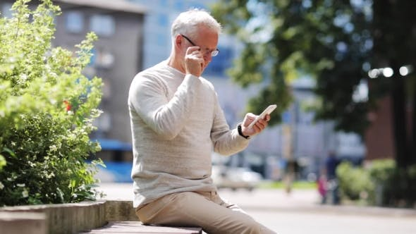 Thumbnail for Senior Man Texting Message On Smartphone In City