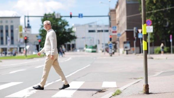 Thumbnail for Senior Man Walking Along City Crosswalk