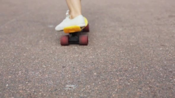 Thumbnail for Teenage Girl Feet Riding Short Modern Skateboard