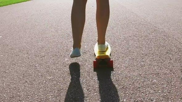Thumbnail for Teenage Girl Feet Riding Short Modern Skateboard