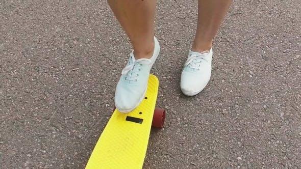 Thumbnail for Teenage Girl Toot Putting Short Skateboard On End