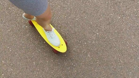 Thumbnail for Teenage Girl Or Woman Riding Short Skateboard