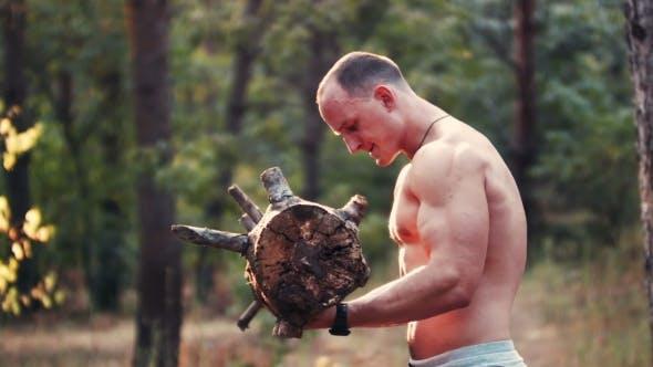 Thumbnail for Muscular Man Lifting a Heavy Log