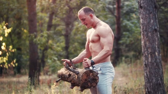 Thumbnail for Muscular Topless Sportsman Doing Biceps Curls in Forest