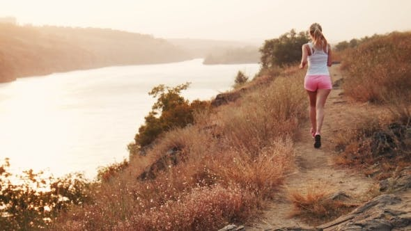 Thumbnail for Sportswoman Jogging In Countryside At Riverside