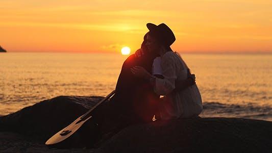 Hugging at Sunset