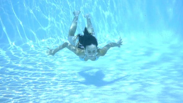 Thumbnail for Girl Swimming Underwater In a Swimming Pool