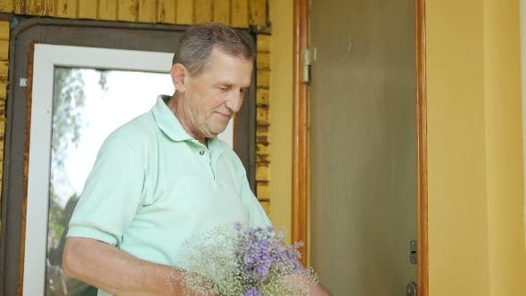 Thumbnail for Man Surprises His Wife a Bouquet Of Flowers.