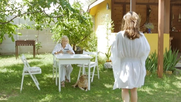 Thumbnail for Woman Sitting With a Tablet Outside In The Garden